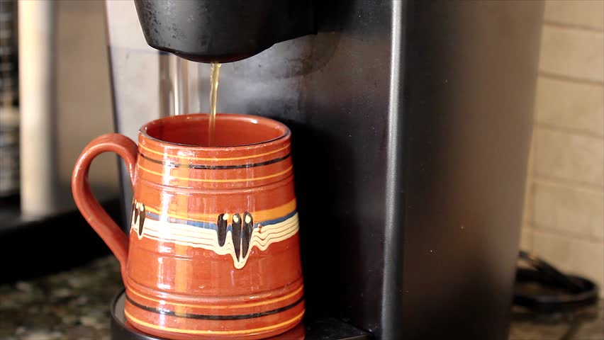 A Modern Coffee Maker Brews into a Single Cup (coffee seen streaming into mug) - HD stock video clip