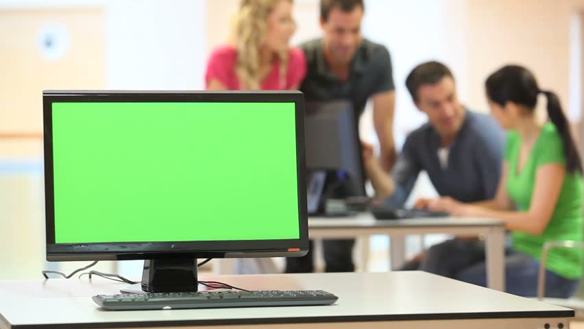 Green desktop screen set in front of workgroup