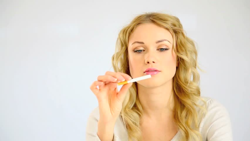 Beautiful blond woman deciding to quit smoking - HD stock footage clip