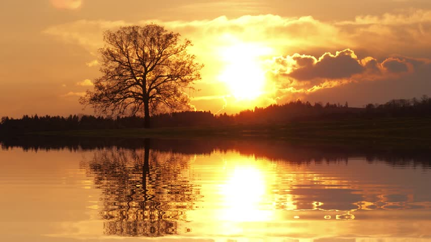 Sundown landscape with water reflection  - HD stock video clip