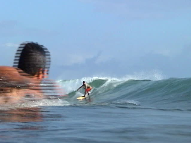 Brazilian surfer catching a wave. - SD stock video clip