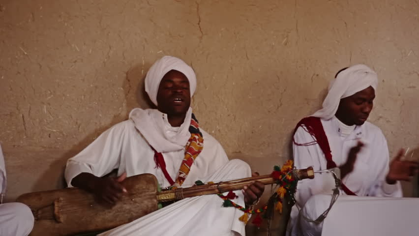 ERG CHEBBI, MOROCCO - OCTOBER 19 2010 - Gnaoua Music Association present traditional Moroccan Gnaoua Music performed by descendants of ancient slaves on October 19, 2010 in Erg Chebbi, Morocco.