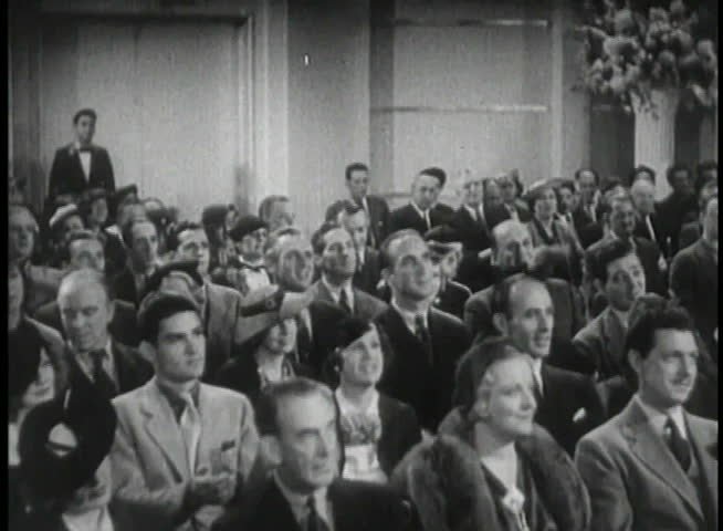 Wide shot of 1930s audience applauding - SD stock footage clip