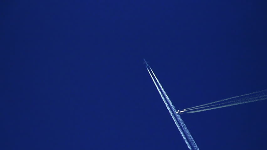 Plane trails crossing against clear blue sky - HD stock video clip
