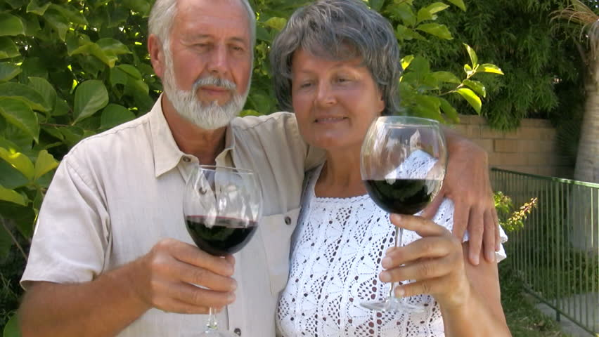 Happy, smiling mature couple drinking wine outdoors - HD stock footage clip