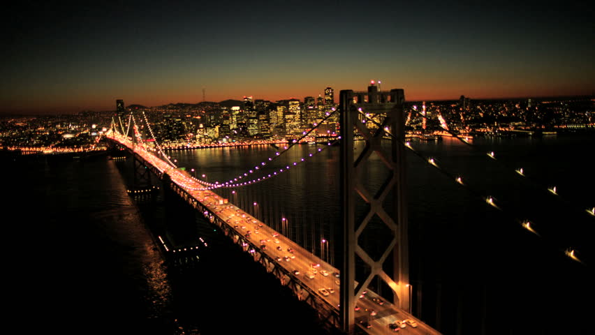Aerial sunset view of the Oakland Bay Bridge at night with the illuminated light from cars, San Francisco city, North America, USA