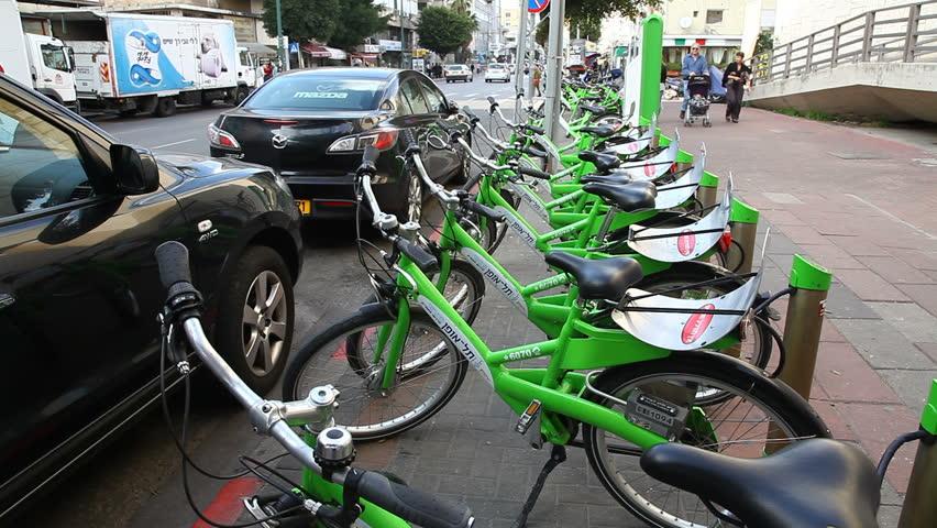 TEL AVIV, ISRAEL - MARCH 26: New public bicycle rental project is on the way in Ben Yehuda Street in Tel Aviv, Israel, March 26, 2012 - HD stock footage clip