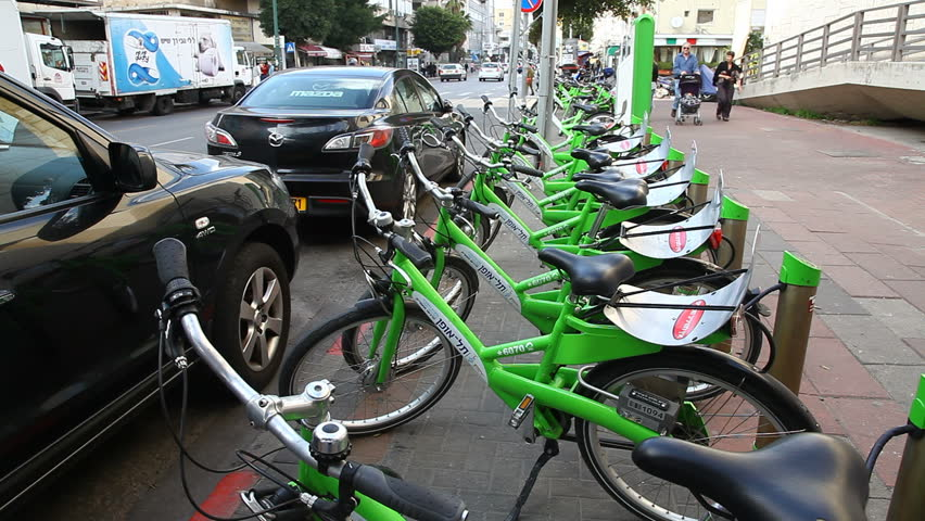 TEL AVIV, ISRAEL - MARCH 26: New public bicycle rental project is on the way in Ben Yehuda Street in Tel Aviv, Israel, March 26, 2012 - HD stock footage clip