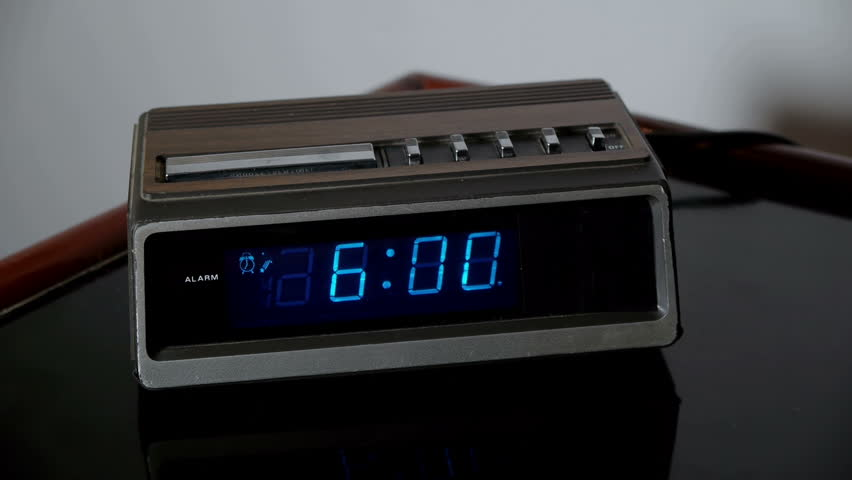 Alarm Clock Wake Up Snooze (HD). Digital alarm clock from the 70s rings and is hastily snoozed by a male hand angry for being woken up at 6am.