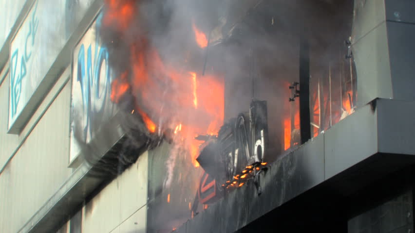 """BANGKOK, THAILAND - APRIL 19: Zen Central Department Store engulfed in smoke and flames during """"Red Shirt"""" violent protest riots on April 19, 2010 in Bangkok, Thailand"""