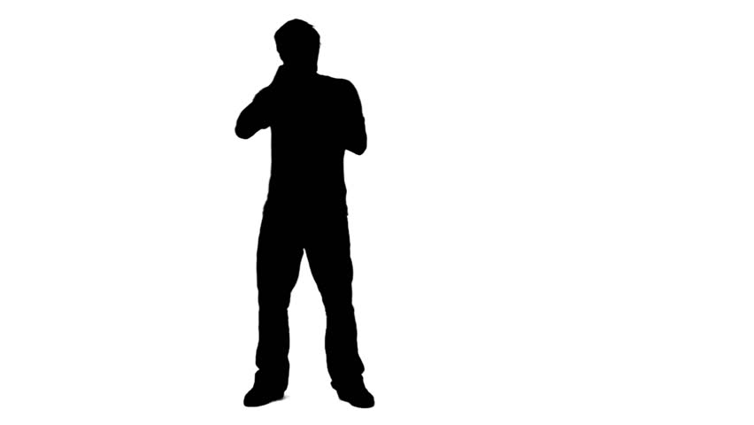 A silhouette man is singing into a microphone against a white background - HD stock footage clip
