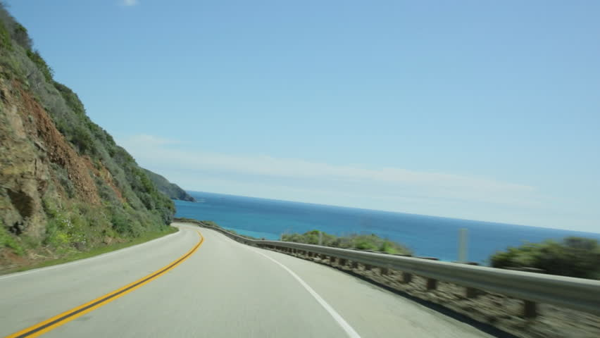 Vehicle point-of-view driving on California Highway 1 (aka Cabrillo Highway or Pacific Coast Highway) in the Big Sur area of Central California.