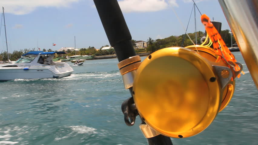 Deep sea fishing reel and rod on moving boat stock footage for Deep sea fishing rod and reel