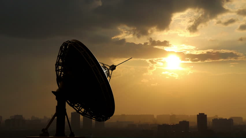 rotating radio telescope at sunset, 3d animation against sky background - HD stock footage clip