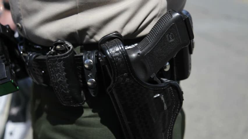 Close up of CHP gun holster - HD stock footage clip