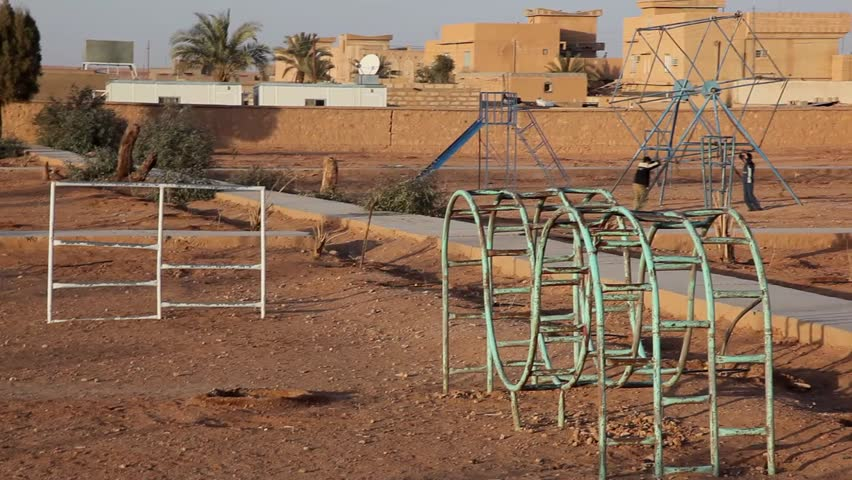 Iraqi children playing in an old playground.
