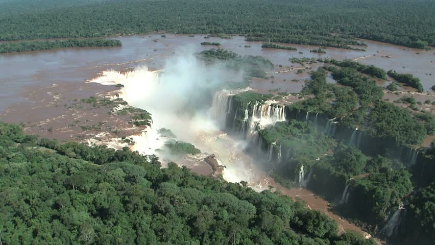 aerial view of Iguazu Falls on Argentina/Brazil border as helicopter starts to move in to main fall, Garganta del Diablo