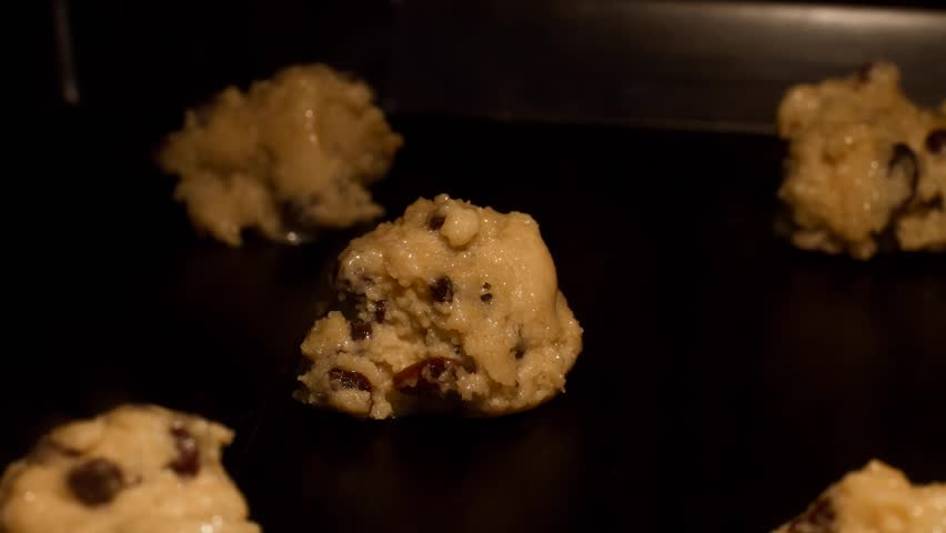 Homemade chocolate chip and raisin cookies - time lapse HD video