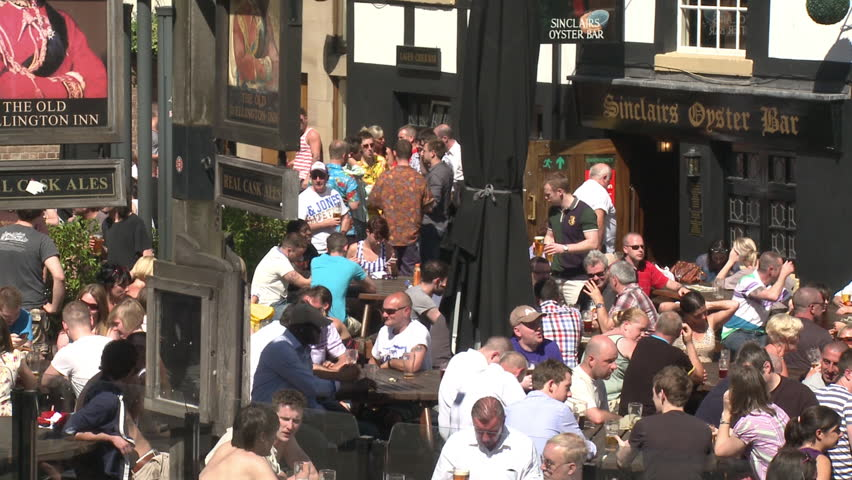 MANCHESTER - MAY 25: Drinkers sit outside English pubs on May 25, 2012 in Manchester, England.