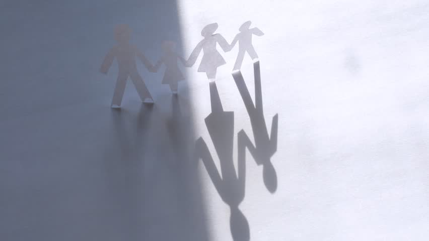Paper figures of family strong hold hands on white background, time lapse - HD stock footage clip