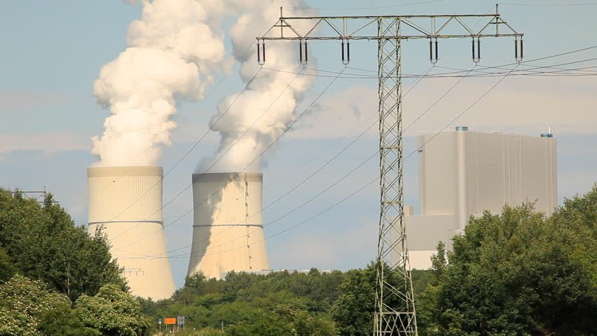 Power plant with cooling towers and electrical towers - HD stock footage clip