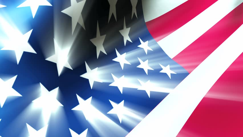 The American flag waves in the breeze as light rays shoot from the stars. - HD stock video clip