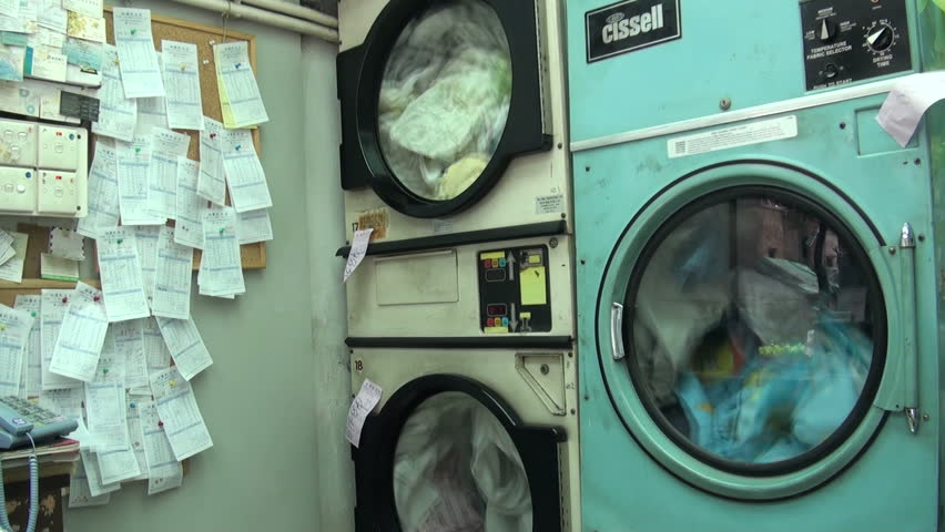 HONG KONG - 28 JULY 2010: Washing machines are turning in a dry cleaning shop in downtown Kowloon, Hong Kong