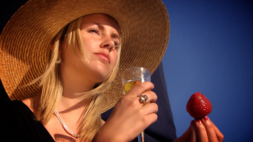 Beautiful blonde girl with champagne & strawberries aboard a yacht - HD stock video clip