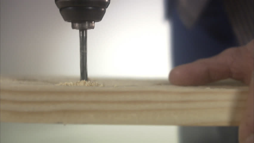 A craftsman using an electric drill - HD stock video clip