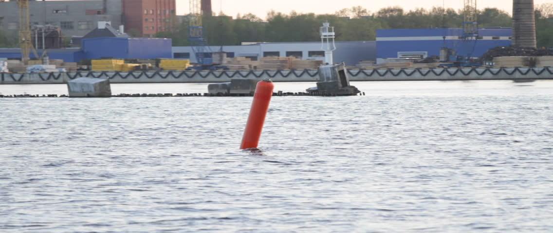 A red buoy, anchored at the Riga Freeport along the Daugava river, in Riga, Latvia.