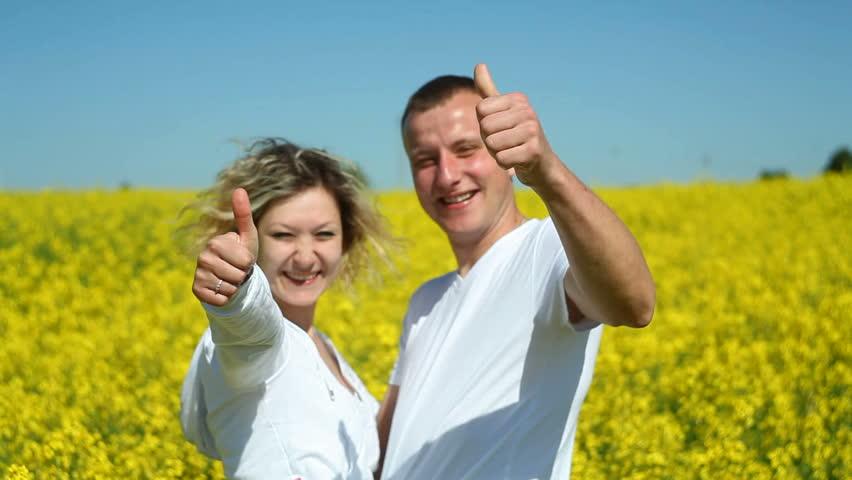 happy couple on rape field