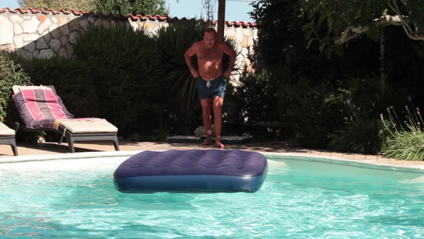 Funny Man Jumping. Video of funny man jumping on water mat in the swimming pool.