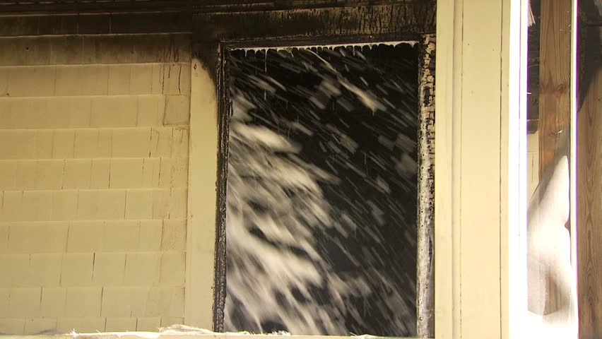Spraying water and foam inside of house on fire - 1