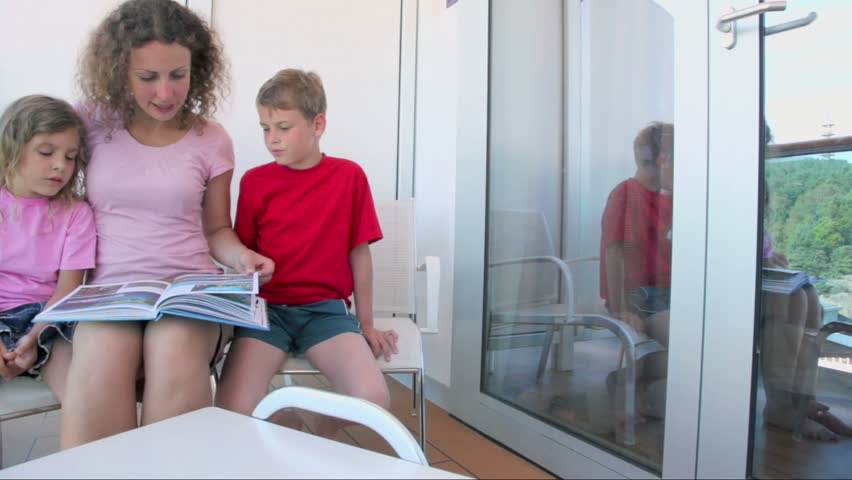 Woman reads book with two her kids boy and little girl at for The balcony book