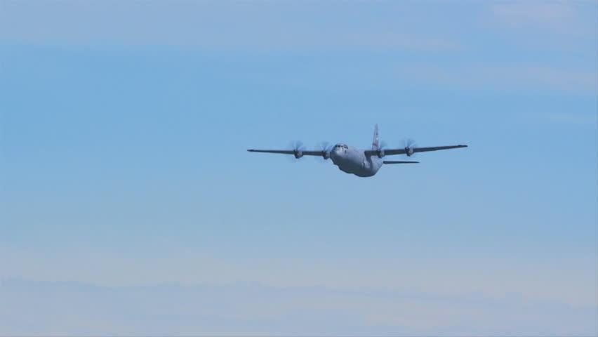 QUONSET, RHODE ISLAND - CIRCA JUNE 2012: Air force C-130 Hercules doing low pass