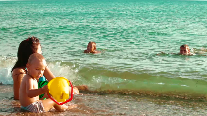 Family Enjoying Summer Vacation On The Beach Stock Footage ...