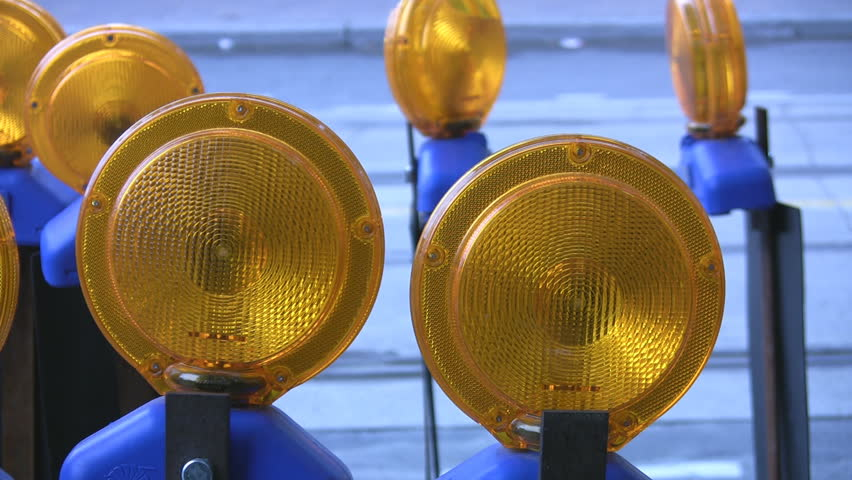 Roadwork lights. Traffic in the background. - HD stock footage clip