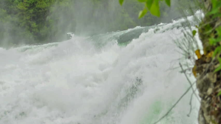 Water of Rhinefall in Switzerland. Part of the famous waterfalls of the river Rhine (Rhein) in Schaffhausen  - HD stock footage clip