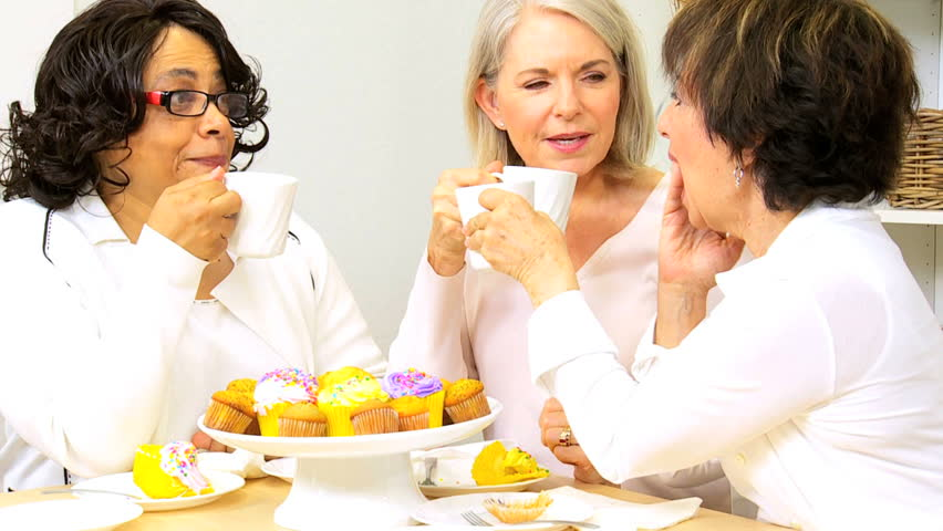 Three senior lady friends enjoying social afternoon with tea and cakes - HD stock footage clip