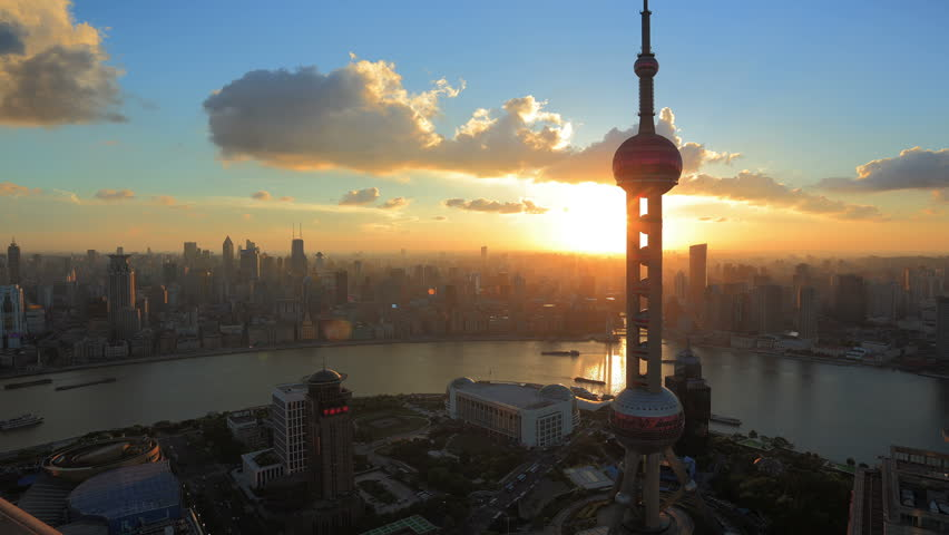 "SHANGHAI, CHINA - CIRCA JULY 2012: Timelapse video of  Shanghai, China Skyline at Sunset circa July 2012. Oriental Pearl Tower and Huangpu River.  >>> Please search similar: "" ShanghaiSkyline "" ."