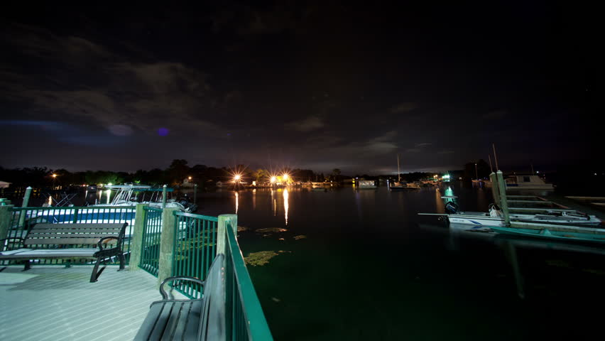 Florida Marina Night Cloud and Boat Time-Lapse Video with Boardwalk Motion