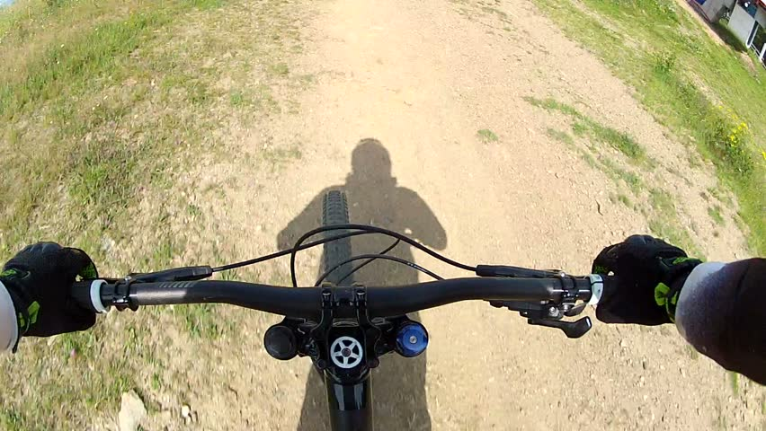 Downhill front view. Ride a bike over terrain pov.