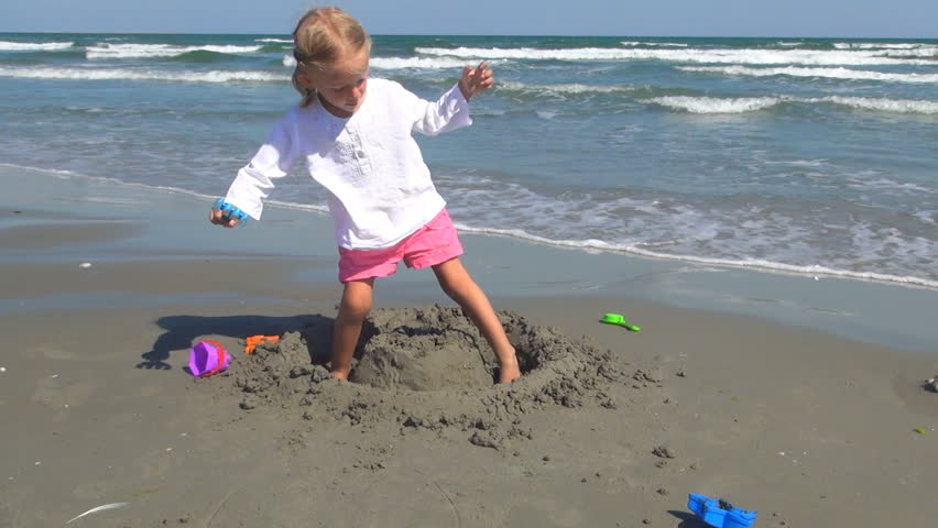 Child Playing on the Beach, Little Girl Having Fun with a Sand Castle - HD stock video clip