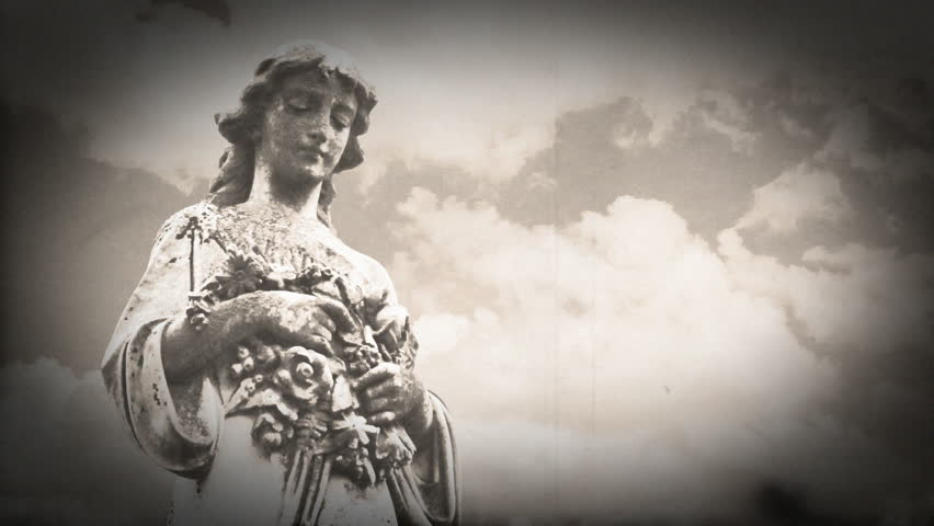 goth gravestone statue angel with timelapse clouds