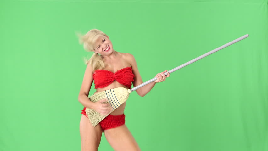 Sexy blond girl in red bikini playing guitar on broomstick and dancing - HD stock video clip