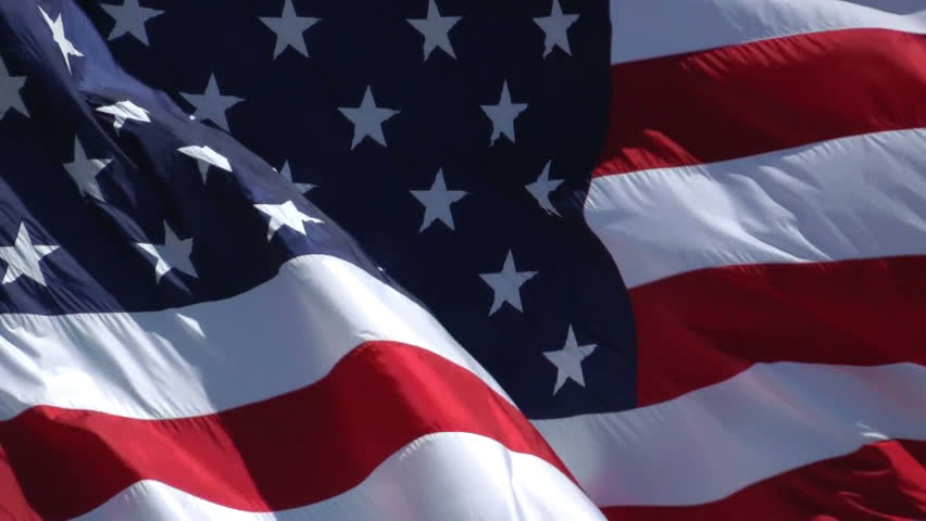 HD zoomed in on the stars and stripes of a jumbo american flag with beautiful ripples in the breeze and sunshine - HD stock footage clip