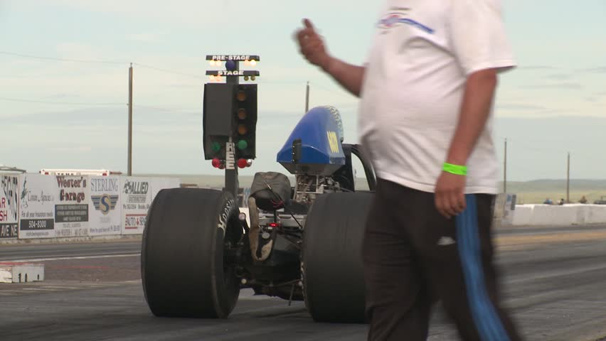 MEDICINE HAT, ALBERTA - CIRCA 2012: motorsports, drag racing, dragster burnout, launch tight frame - HD stock footage clip