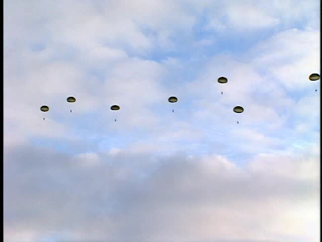 parachutist soldiers floating to ground (BetacamSP, good audio) - SD stock footage clip