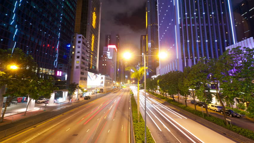 Street traffic in Hong Kong at night, timelapse in motion - HD stock video clip