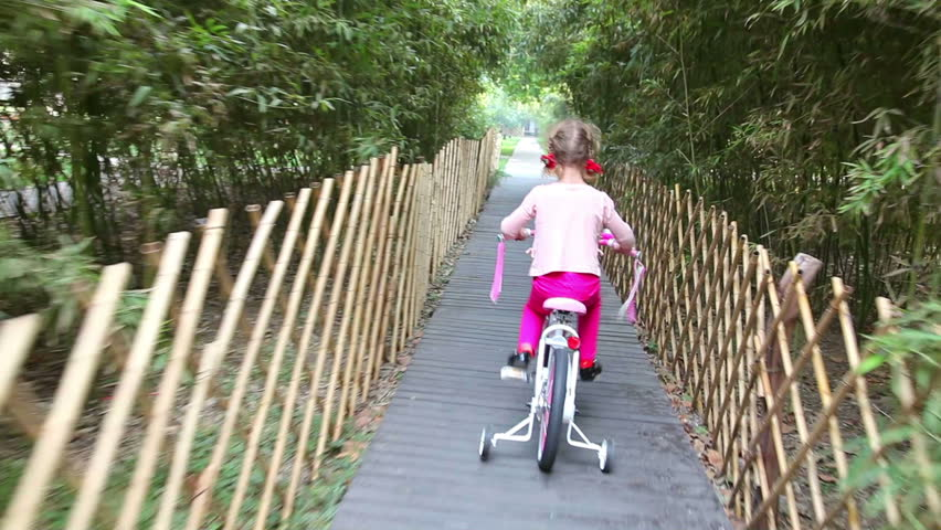 Little girl on bike - HD stock video clip